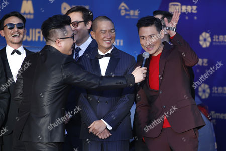 Hong Kong Singer Jacky Cheung Waves As He Arrives on the Red Carpet For the Closing Ceremony of the 5th Beijing International Film Festival in Beijing China 23 April 2015 the Event was Held From 16 to 23 April China Beijing