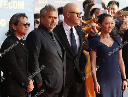 (l-r) Hong Kong Filmmaker Peter Chan French Director Luc Besson Russian Filmmaker Fedor Bondarchuk and Chinese Actress Zhou Xun Pose For Photos on the Red Carpet at the Opening of the Beijing International Film Festival in Beijing China 16 April 2015 the Event is Held at Yanqi Lake From 16 to 23 April China Beijing