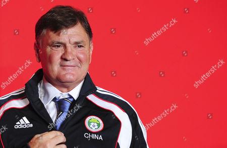 Spanish Soccer Legend Jose Antonio Camacho Wearing the Official Jacket of the Chinese Football Association During the Contract Signing Ceremony in Beijing China 14 August 2011 Camacho Signed a Three Year Contract As Head Coach of China's Soccer Team He was Dismissed by Mid 2013 Following the Team's Non-qualification For the World Cup China Beijing