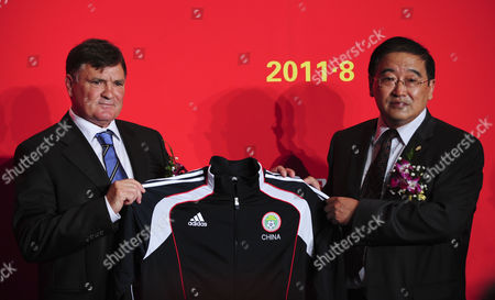Spanish Soccer Legend Jose Antonio Camacho (l) and Wei Di (r) Chief of the Chinese Football Association (cfa) Present Camacho's Official Jacket of the Chinese Football Association During the Contract Signing Ceremony in Beijing China 14 August 2011 Camacho Signed a Three Year Contract As Head Coach of China's Soccer Team He was Dismissed by Mid 2013 Following the Team's Non-qualification For the World Cup China Beijing