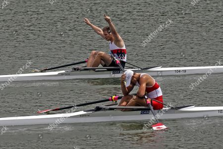 Tim Ole Naske (back) of Germany and Dan De Groot of Canada React at the End of Their Rowing Junior Men's Pair Final a at Xuan Wu Lake in Nanjing Youth Olympic Games 2014 in Nanjing China 20 August 2014 the Nanjing Youth Olympic Games 2014 Runs From From 16 to 28 August 2014 China Nanjing