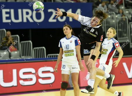 Germany's Anne Mueller (c) in Action Against Slovakia's Petra Benuskova (l) During the Women's European Championship Main Round Group Ii Handball Match Between Germany and Slovakia in Zagreb Croatia 17 December 2014 Croatia Zagreb