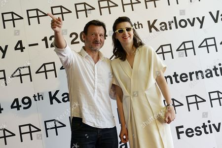 Stock Photo of Polish Director Robert Wieckiewicz (l) and Polish Actress Agnieszka Grochovska Pose For Photographers Before Press Conference For the Movie 'Walesa: Man of Hope' During the 49th Karlovy Vary International Film Festival in Karlovy Vary Czech Republic 06 July 2014 the Film Festival Runs Until 12 July Czech Republic Karlovy Vary