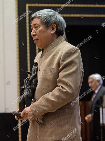 Chinese Writer Yan Lianke Leaves the Stage After He Received the Franz Kafka Award 2014 by the Franz Kafka Society Cultural Organization in the Old Town Hall of Prague in Prague Czech Republic 22 October 2014 Czech Republic Prague