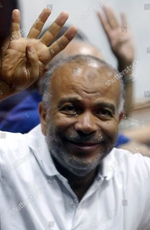 Egypt's Muslim Brotherhood Member Saad Al-katatni Flashes the Four-finger Sign From Behind Dock Bars During a Trial Session in Cairo Egypt 13 July 2014 Ousted President Mohamed Morsi and Some 130 Defendants From the Muslim Brotherhood Face a Trial on Charges of Allegedly Escaping From Prison Back in 2011 During the Early Days of the Uprising Egypt Cairo