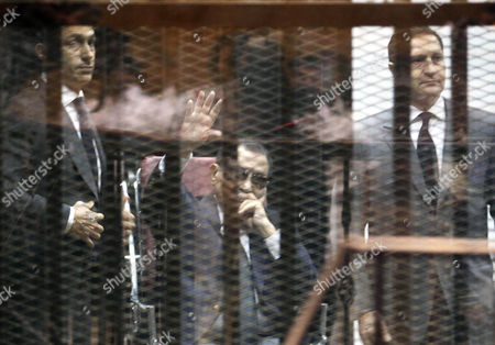Former Egyptian President Hosni Mubarak (c) Flanked by His Sons Gamal Mubarak (l) and Brother Alaa Mubarak (r) Waves From the Defendants' Cage During Their Trial at the Police Academy in Cairo Egypt 09 May 2015 According to Local Reports an Egyptian Court Sentenced Mubarak to Three Years in Prison in a Retrial on Charges of Corruption Handing Down the Same Sentence to His Sons Alaa and Gamal and Ordering All Three to Pay a Fine of 125 Million Egyptian Pounds (16 4 Million Dollars) Epa/khaled Elfiqi Egypt Cairo