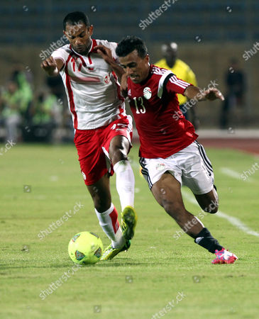 Egyptian Player Mohamed Abdel Shafy (r) Fights For the Ball with Tunisia Player Saber Khelifa (l) During the African Cup of Nations 2015 Qualifying Soccer Match Between Egypt and Tunisia at the Air Defence Stadium in Cairo Egypt 10 September 2014 Egypt Cairo
