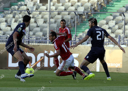 Al Ahly's Walid Soliman (c) Fights For the Ball with Etoile Du Sahel's Hamdi Naguez (r) and Rami Bedoui (l) During Their Caf Confederation Cup Group B Soccer Match at the Cairo Stadium in Cairo Egypt on 23 August 2014 Egypt Cairo