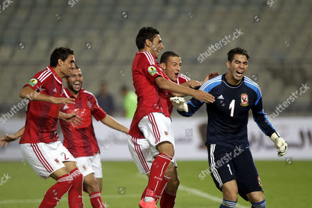Stock Picture of Al-ahly Goalkeeper Sherif Ekramy (r) Celebrates with Teammates After Winning the Egyptian Super Cup Soccer Match Against Zamalek at Cairo Stadium in Cairo Egypt 14 September 2014 Egypt Cairo