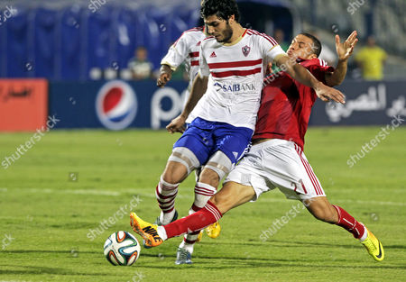 Al-ahly's Ahmed Abd El-zaher (r) Fights For the Ball with Zamalek Player Ali Gabr (l) During the Egyptian Super Cup Soccer Match Against Zamalek at Cairo Stadium in Cairo Egypt 14 September 2014 Egypt Cairo