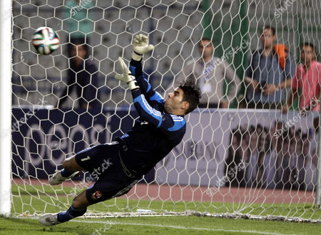Al Ahly Goalkeeper Sherif Ekramy Saves a Penalty Kick During the Egyptian Super Cup Soccer Match Against Zamalek at Cairo Stadium in Cairo Egypt 14 September 2014 Egypt Cairo