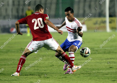 Al-ahly's Player Saad Samir (l) Fights For the Ball with Zamalek's Mohamed Abdel Shafy (r) During Their Egyptian Super Cup Soccer Match at Cairo Stadium in Cairo Egypt 14 September 2014 Egypt Cairo
