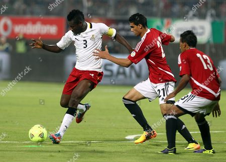 Egyptian Players Mohamed Nagieb (c) and Mohamed Abdel-shafy (r) Fight For the Ball with Asamoah Gyan (l) of Ghana During the Fifa World Cup 2014 Qualifying Playoff Second Leg Soccer Match Between Egypt and Ghana in Cairo Egypt 19 November 2013 Egypt Cairo