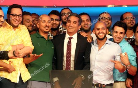Egypt's Popular Satirist Bassem Youssef (c) Poses For a Photo with the Crew of His Show 'Al-bernameg' During a Press Conference in Cairo Egypt 02 June 2014 Youssef Said on 02 June That His Show Will not Be Returning to Television Youssef's Program Al-bernameg Which Means the Show was Broadcast on the Saudi-funded Mbc Network the Show Had Taken a One-month Vacation and Had Been Scheduled to Return on 30 May Two Days After the Presidential Election Ended However It was Suspended Egypt Cairo