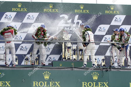 Champagn on the Podium of the Le Mans 24 Hours Race in Le Mans France 15 June 2014 Audi Sport Joest Team Ní 2 in a Audi R18 E-tron Quattro Driven by Marcel Fassler of Switzerland Andre Lotterer of Germany and Benoit Treluyer of France Finish at the First Place (c) Audi Sport Team Joest Ní1 in Audi R18 E-tron Quattro Driven by Lucas Di Grassi of Brazil Loic Duval of France and Tom Kristensen of Denmark Finish at the Second Place (l) and Toyota Racing Ní 8 with a Toyota Ts 040 Hybrid Na 8 Driven by Anthony Davidson of Great Britain Nicolas Lapierre of France and Sebastien Buemi of Switzerland Finish at the Third Place (r) France Le Mans