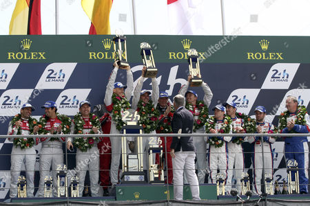 Podium of the Le Mans 24 Hours Race in Le Mans France 15 June 2014 Audi Sport Joest Team Ní 2 in a Audi R18 E-tron Quattro Driven by Marcel Fassler of Switzerland Andre Lotterer of Germany and Benoit Treluyer of France Finish at the First Place (c) Audi Sport Team Joest Ní1 in Audi R18 E-tron Quattro Driven by Lucas Di Grassi of Brazil Loic Duval of France and Tom Kristensen of Denmark Finish at the Second Place (l) and Toyota Racing Ní 8 with a Toyota Ts 040 Hybrid Na 8 Driven by Anthony Davidson of Great Britain Nicolas Lapierre of France and Sebastien Buemi of Switzerland Finish at the Third Place (r) France Le Mans