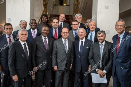French President Francois Hollande (front C) Poses with (front Row) Ceo of Tunisia's Pireco Company (petroleum and Industrial Realization Contractors) Abdessalem Ben Ayed (l) Nigerian Businessman Aliko Dangote (2-l) President and Ceo of Bmce Bank (moroccan Bank For External Trade) Othman Benjelloun (3-r) General Manager of the Benamor Group and President of the Algerian Chamber of Commerce and Industry Laid Benamor (2-r) Africafrance Co-president Lionel Zinsou (r) and (back Row) French President of the National Federation of Farmers' Union (fnsea) Xavier Beulin (2-l) Engie French Deputy Ceo Pierre Mongin (3-l) President of the General Confederation of Ivoirian Companies Jean Kacou Diagou (4-l) Business France French President Seybah Dagoma (5-l) French Junior Minister For Foreign Trade and Tourism Matthias Fekl (6-l) French Telecom Operator Orange Ceo Stephane Richard (7-l) French Secretary of State For Industry Christophe Sirugue (4-r) President of the Company Afrimedia Sa Constant Nemale (2-r) For a Family Picture Following a Meeting with French-african Entrepreneurs Involved in Africa at Elysee Palace in Paris France 07 October 2016 France Paris