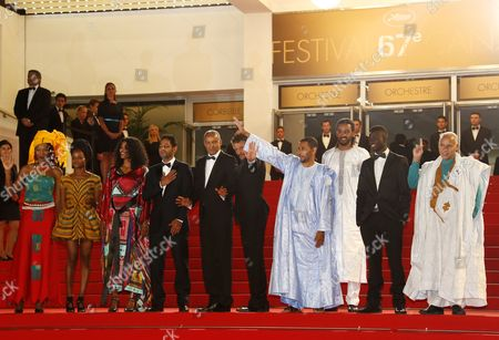 Mauritanian-born Director Abderrahmane Sissako (5-l) Actress Toulou Kiki (3-l) Actor Ibrahim Ahmed Aka Pino (3-r) Tunisian Actor Hichem Yacoubi (4-l) Tunisian Actor Abel Jafri (5-r) and Guests Arrive For the Screening of 'Timbuktu' During the 67th Annual Cannes Film Festival in Cannes France 15 May 2014 the Movie is Presented in the Official Competition of the Festival Which Runs From 14 to 25 May France Cannes