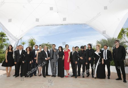 Turkish Actress Melisa Sozen (9-l) Turkish Actor Haluk Bilginer (10-l) Turkish Director Nuri Bilge Ceylan (11-l) and Turkish Actress Demet Akbag (9-r) Pose with the Crew During the Photocall For 'Winter Sleep' at the 67th Annual Cannes Film Festival in Cannes France 16 May 2014 They Wear a Black Ribbon in Support of the Victims of the Mine Disaster in Soma Turkey the Movie is Presented in the Official Competition of the Festival Which Runs From 14 to 25 May France Cannes