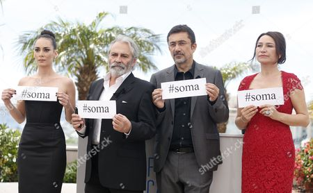 (l-r) Turkish Actress Melisa Sozen Turkish Actor Haluk Bilginer Turkish Director Nuri Bilge Ceylan and Turkish Actress Demet Akbag Hold Signs Reading '#soma' As They Pose During the Photocall For 'Winter Sleep' at the 67th Annual Cannes Film Festival in Cannes France 16 May 2014 They Wear a Black Ribbon in Support of the Victims of the Mine Disaster in Soma Turkey the Movie is Presented in the Official Competition of the Festival Which Runs From 14 to 25 May France Cannes