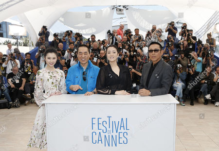(l-r) Chinese Actress Zhang Huiwen Chinese Director Zhang Yimou Chinese Actress Gong Li and Chinese Actor Chen Daoming Pose During the Photocall For 'Gu Lai' (coming Home) at the 67th Annual Cannes Film Festival in Cannes France 20 May 2014 the Movie is Presented out of Competition at the Festival Which Runs From 14 to 25 May France Cannes