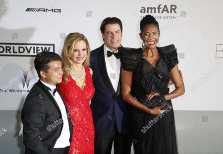 (l-r) Italian Fashion Agent Oscar Generale Us Actor John Travolta His Wife Kelly Preston and Dominican-born Danny Mendez Attend the Cinema Against Aids Amfar Gala 2014 Held at the Hotel Du Cap Eden Roc in Cap D'antibes France 22 May 2014 During the 67th Annual Cannes Film Festival the Festival Runs From 14 to 25 May France Cannes