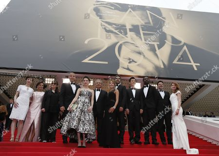 Cast of the Movie 'Qu'est-ce Qu'on a Fait Au Bon Dieu?' (l-r) Actors Emilie Caen Isabelle De Araujo Chantal Lauby Medi Sadoun Frederique Bel Christian Clavier Elodie Fontan Ary Abittan Frederic Chau Noom Diawara Director Philippe De Chauveron and Julia Piaton Arrive For the Screening of 'Jimmy's Hall' During the 67th Annual Cannes Film Festival in Cannes France 22 May 2014 the Movie is Presented in the Official Competition of the Festival Which Runs From 14 to 25 May France Cannes