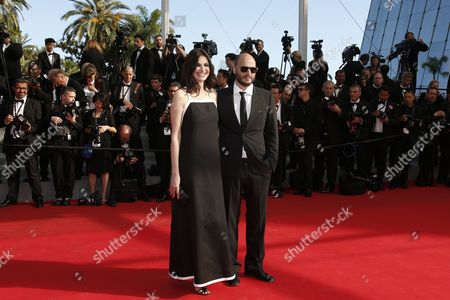 Belgian Actress and Singer Helena Noguerra (l) and Partner Belgian Director Fabrice Du Welz (r) Arrive For the Screening of 'Sils Maria' (clouds of Sils Maria) During the 67th Annual Cannes Film Festival in Cannes France 23 May 2014 the Movie is Presented in the Official Competition of the Festival Which Runs From 14 to 25 May France Cannes