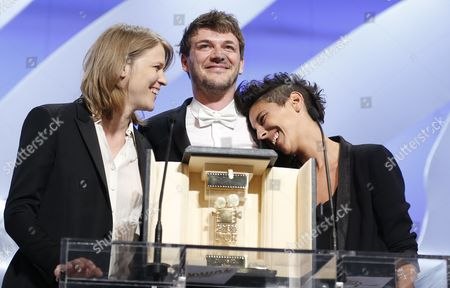 French Co-directors (l-r) Claire Burger Samuel Theis and Marie Amachoukeli Receive the Golden Camera Award For Their Movie 'Party Girl' During the Closing Award Ceremony of the 67th Cannes Film Festival in Cannes France 24 May 2014 France Cannes