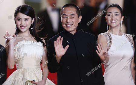 Chinese Actress Zhang Huiwen (l) Chinese Director Zhang Yimou (c) and Chinese Actress Gong Li (r) Arrive For the Screening of 'Gu Lai' (coming Home) During the 67th Annual Cannes Film Festival in Cannes France 20 May 2014 the Movie is Presented out of Competition at the Festival Which Runs From 14 to 25 May France Cannes