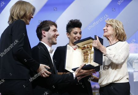 Stock Image of French Co-directors (l-r) Claire Burger Samuel Theis and Marie Amachoukeli Receive the Golden Camera Award For Their Movie 'Party Girl' From President of the Golden Camera Jury French Director and Actress Nicole Garcia (r) During the Closing Award Ceremony of the 67th Cannes Film Festival in Cannes France 24 May 2014 France Cannes