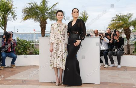 Chinese Actress Gong Li (r) and Chinese Actress Zhang Huiwen (l) Pose During the Photocall For 'Gu Lai' (coming Home) at the 67th Annual Cannes Film Festival in Cannes France 20 May 2014 the Movie is Presented out of Competition at the Festival Which Runs From 14 to 25 May France Cannes
