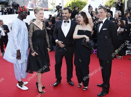 Stock Image of (l-r) Senegalese Director Moussa Toure Norwegian-swedish Actress Maria Bonnevie Argentinian Director Pablo Trapero French Actress Geraldine Pailhas and President of the Criterion Collection Peter Becker Arrive For the Screening of 'Mr Turner' During the 67th Annual Cannes Film Festival in Cannes France 15 May 2014 the Movie is Presented in the Official Competition of the Festival Which Runs From 14 to 25 May France Cannes