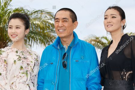 Chinese Actress Zhang Huiwen (l) Chinese Actress Gong Li (r) and Chinese Director Zhang Yimou (c) Pose During the Photocall For 'Gu Lai' (coming Home) at the 67th Annual Cannes Film Festival in Cannes France 20 May 2014 the Movie is Presented out of Competition at the Festival Which Runs From 14 to 25 May France Cannes