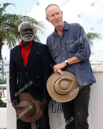 Stock Image of Dutch Australian Director Rolf De Heer (r) and Yolngu Man Aboriginal Peter Djigirr (l) Pose During the Photocall For 'Charlie's Country' at the 67th Annual Cannes Film Festival in Cannes France 23 May 2014 the Movie is Presented in the Section Un Certain Regard of the Festival Which Runs From 14 to 25 May France Cannes