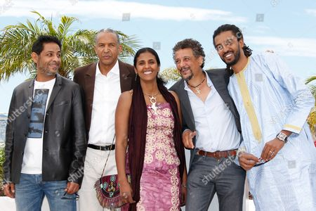 Stock Image of (l-r) Tunisian Actor Hichem Yacoubi Mauritanian-born Director Abderrahmane Sissako Actress Toulou Kiki Tunisian Actor Abel Jafri and Actor Ibrahim Ahmed Aka Pino Pose During the Photocall For 'Timbuktu' at the 67th Annual Cannes Film Festival in Cannes France 15 May 2014 the Movie is Presented in the Official Competition of the Festival Which Runs From 14 to 25 May France Cannes
