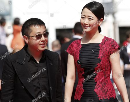Jury Member Chinese Director Jia Zhangke (l) and Chinese Actress Tao Zhao (r) Arrive For the Screening of 'Futatsume No Mado' (still the Water) During the 67th Annual Cannes Film Festival in Cannes France 20 May 2014 the Movie is Presented in the Official Competition of the Festival Which Runs From 14 to 25 May France Cannes