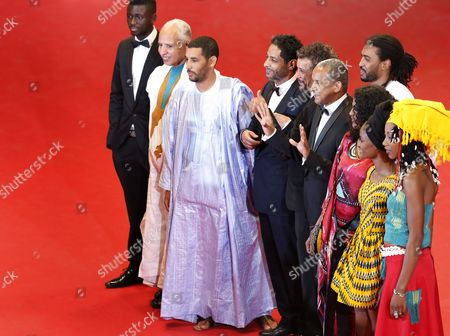 Stock Photo of Mauritanian-born Director Abderrahmane Sissako (5-r) Actress Toulou Kiki (3-r) Actor Ibrahim Ahmed Aka Pino (4-r) Tunisian Actor Hichem Yacoubi (4-l) Tunisian Actor Abel Jafri (5-l) and Guests Arrive For the Screening of 'Timbuktu' During the 67th Annual Cannes Film Festival in Cannes France 15 May 2014 the Movie is Presented in the Official Competition of the Festival Which Runs From 14 to 25 May France Cannes
