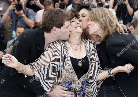French Actress Angelique Litzenburger (2-l) is Kissed by French Co-directors Samuel Theis (l) Marie Amachoukeli (2-r) and Claire Burger (r) Pose During the Photocall For 'Party Girl' at the 67th Annual Cannes Film Festival in Cannes France 15 May 2014 the Movie is Presented in the Section Un Certain Regard of the Festival Which Runs From 14 to 25 May France Cannes