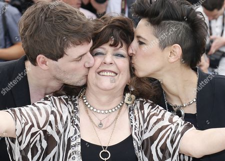 French Actress Angelique Litzenburger (c) is Kissed by French Co-directors Samuel Theis (l) and Marie Amachoukeli (r) Pose During the Photocall For 'Party Girl' at the 67th Annual Cannes Film Festival in Cannes France 15 May 2014 the Movie is Presented in the Section Un Certain Regard of the Festival Which Runs From 14 to 25 May France Cannes