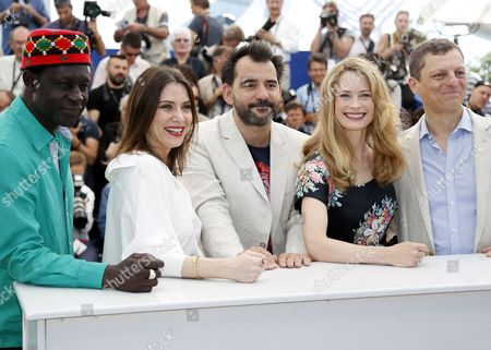 Un Certain Regard Jury Members Senegalese Director Moussa Toure French Actress Geraldine Pailhas Argentinian Director Pablo Trapero Norwegian-swedish Actress Maria Bonnevie and President of the Criterion Collection Peter Becker Pose During a Photocall at the 67th Annual Cannes Film Festival in Cannes France 17 May 2014 the Festival Runs From 14 to 25 May France Cannes