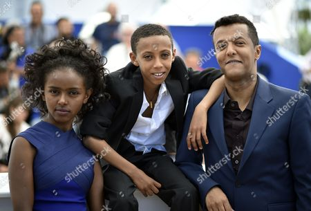 Stock Image of (l-r) Ethiopian Actress Kidist Siyum Ethiopian Actor Rediat Amare and Ethiopian Director Yared Zeleke Pose During the Photocall For 'Lamb' at the 68th Annual Cannes Film Festival in Cannes France 20 May 2015 the Movie is Presented in the Section Un Certain Regard of the Festival Which Runs From 13 to 24 May France Cannes