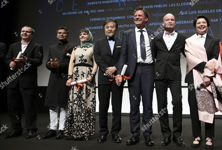 (l-r) Award Winners Romanian Director Corneliu Porumboiu Indian Director Neeraj Ghaywan Iranian Director Ida Panahandeh Japanese Director Kiyoshi Kurosawa Croatian Director Dalibor Matanic Icelandic Director Grimur Hakonarson and Jury President Italian Actress Isabella Rossellini Pose For Photographs During the Un Certain Regard Award Ceremony of the 68th Cannes Film Festival in Cannes France 23 May 2015 the Festival Runs From 13 to 24 May France Cannes