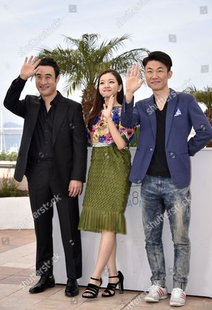 (l-r) South Korean Actor Bae Sung-woo South Korean Actress Ko Ah-sung and South Korean Director Hong Won-chan Pose During the Photocall For 'O Piseu' (office) During the 68th Annual Cannes Film Festival in Cannes France 19 May 2015 the Movie is Presented in the Section Midnight Screenings at the Festival Which Runs From 13 to 24 May France Cannes