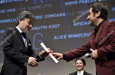 Japanese Director Kiyoshi Kurosawa (l) Receives the Un Certain Regard Best Director Prize For His Film 'Kishibe No Tabi' (journey to the Shore) From Greek Director Panos H Koutras (r) During the Un Certain Regard Award Ceremony of the 68th Cannes Film Festival in Cannes France 23 May 2015 the Festival Runs From 13 to 24 May France Cannes