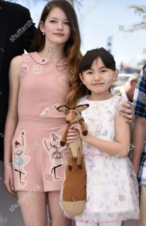 Stock Image of Us Actress Mackenzie Foy (l) and Japanese Actress Rio Suzuki (r) Pose During the Photocall For 'The Little Prince' at the 68th Annual Cannes Film Festival in Cannes France 22 May 2015 the Movie is Presented out of Competition at the Festival Which Runs From 13 to 24 May France Cannes