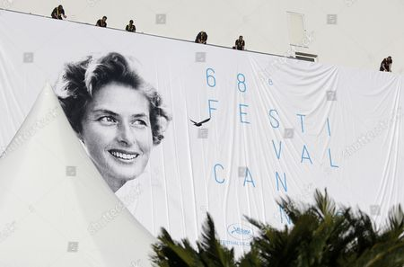 Workers Set Up the Official Poster of the 68th Annual Cannes Film Festival on the Palais Des Festivals Facade in Cannes France 11 May 2015 the Poster Displays a Photograph of Swedish Actress Ingrid Bergman Taken by Polish Photographer David Seymour the Film Festival Will Run From 13 to 24 May France Cannes