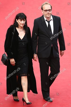 French Director Xavier Beauvois (r) and French Producer Sylvie Pialat (l) Arrive For the Screening of 'La Tete Haute' (standing Tall) and the Opening Ceremony of the 68th Annual Cannes Film Festival in Cannes France 13 May 2015 Presented out of Competition the Movie Opens the Festival Which Runs From 13 to 24 May France Cannes