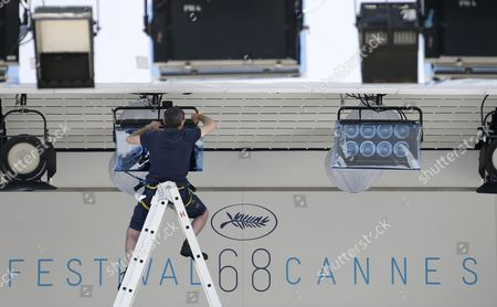 A Worker Sets Up Lights at the Palais Des Festivals Before the 68th Annual Cannes Film Festival in Cannes France 11 May 2015 the Poster Displays a Photograph of Swedish Actress Ingrid Bergman Taken by Polish Photographer David Seymour the Film Festival Will Run From 13 to 24 May France Cannes