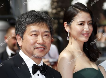 (l-r) Japanese Director Hirokazu Kore-eda and Japanese Actress Masami Nagasawa Arrive For the Screening of 'Umimachi Diary' (our Little Sister) During the 68th Annual Cannes Film Festival in Cannes France 14 May 2015 the Movie is Presented in the Official Competition of the Festival Which Runs From 13 to 24 May France Cannes